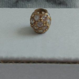 gold charm with cubic zirconia